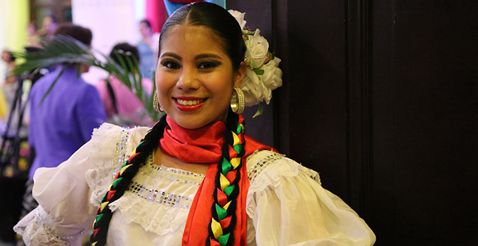 Photo of a woman dressed in a festival costume.